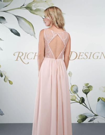 Dress featuring full chiffon skirt, lace bodice and keyhole back.
