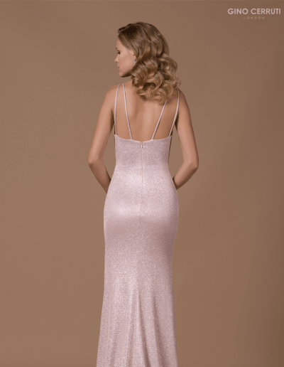 Sparkly floor length gown with illusion panel and thigh high slit.