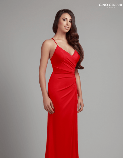 Floor length gown with ruched detailing. Complete with V-neck and lace up back.
