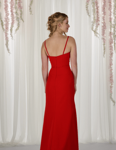 Chiffon gown with asymmetrical front pleating in the bodice, V-neckline and spaghetti straps.