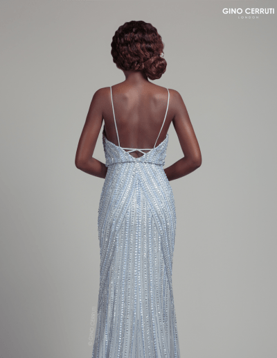 Hand beaded dress with drape bodice and spaghetti straps, complete with an open back.