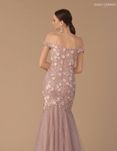 Romantic ballgown with flower appliques. Completed with fishtail skirt and off the shoulder neckline.
