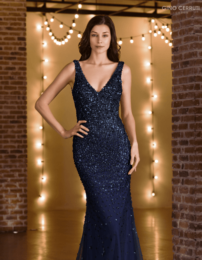Delicate beading makes its way down this gown, working into a subtle fishtail skirt.