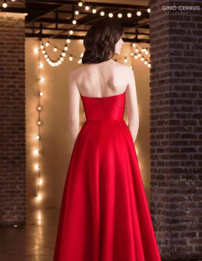 Strapless sweetheart ballgown which flows into an A-line skirt, complete with pockets.