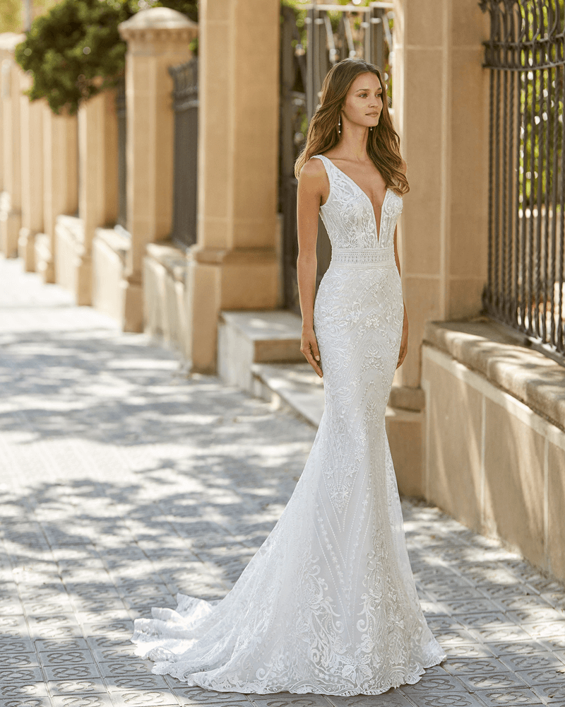 Mermaid-style beaded lace wedding dress. Deep-plunge neckline and V-back.
